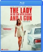 THE LADY IN THE CAR WITH GLASSES AND A GUN - Thumb 1